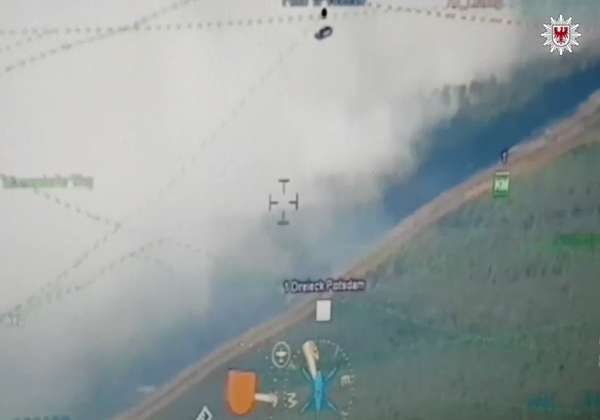 News video: German Police Helicopter Surveys Forest Fire Threatening Town