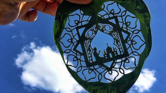 News video: Liebe zum Detail: Künstler schneidet Bilder aus Blättern und Papier